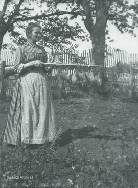 Isabella Stark McMorran with a rifle