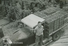Dixon Holloway standing beside berry truck