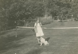 [Elizabeth Tatlow's granddaughter?] and dog on grass tennis court