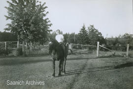 Unidentified person on horseback [at the Holloway farm?]