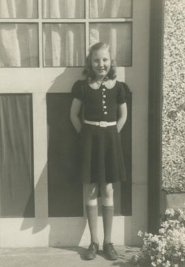 Eileen Archer standing beside garage door at her home at 2957 Orillia Street