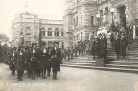 Guides parade past Guide leaders and others on the steps of the BC Parliament Building