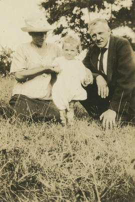 Frank and May Aitkens with baby Lorna on front lawn of Aitkens family home
