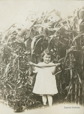 C.F. Dawson and daughter Barbara in corn field