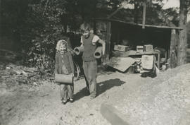 Mena and Leslie G. Underwood carrying drain pipes for new house at 5424 Fowler Road