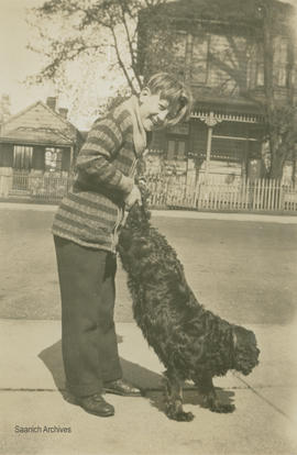 Ted Stone playing with a dog