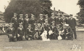Postcard of Muggins the Red Cross dog with members of the Royal Naval Canadian Volunteer Reserve ...