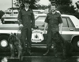 Police officers with dogs