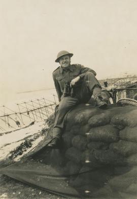 Ernie Underwood sitting on sandbag wall