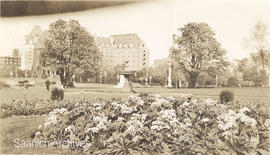 Flower beds and fountain on the grounds of the Parliament Building, Empress Hotel in background
